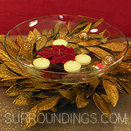 gold bay leaf floating candle centerpiece