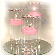 Small cylinders & crystal bands floating candle centerpiece