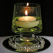 Garden vase with floating candle