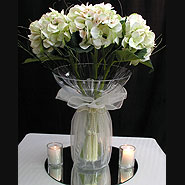 White hydrangea in champagne bowl with organza wrap