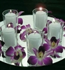 Orchids and votives on centerpiece mirror