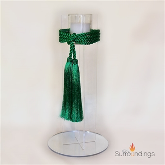 Hanging centerpiece in glass cone sconce with call lily flowers and pine/bell spray