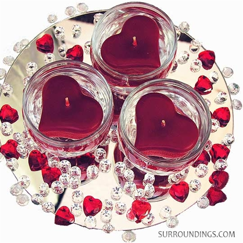 Floating heart candle centerpiece with Cupid mix.