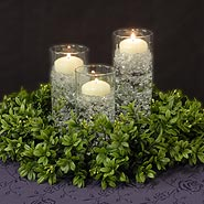 Boxwood wreath with small cylinder set and floating candles