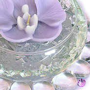 Flower candle in lily bowl centerpiece