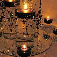 glass cylinders with bead garland candle centerpiece